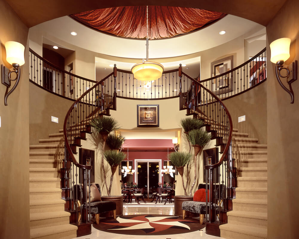 Elegant double winding stairs into large round foyer