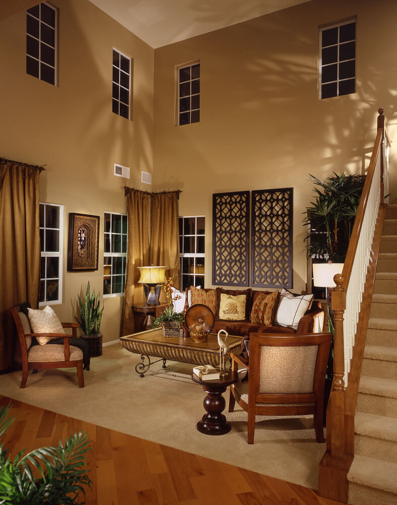 living room tucked into alcove adjacent to staircase the area has 2 story ceiling - Formal Living Room Design Ideas