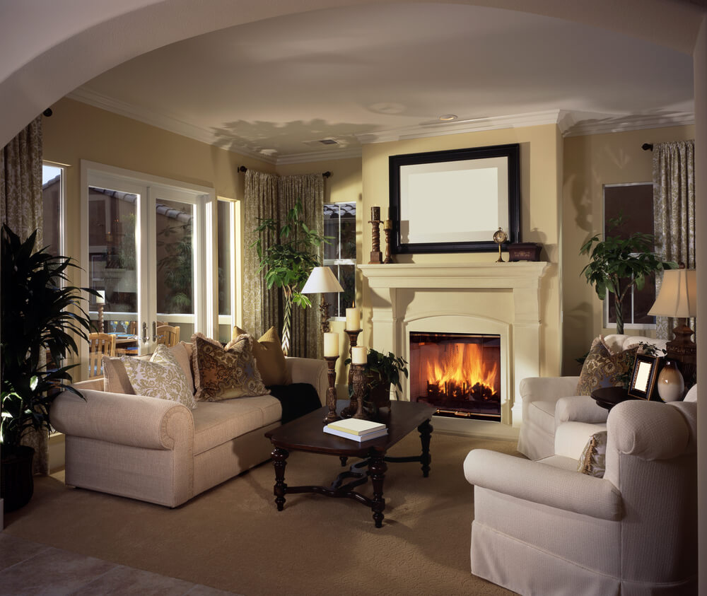 Picture of a large open living rooms space with tall fireplace ...