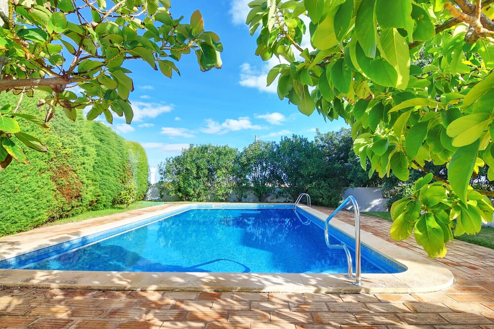 Backyard Pool Ideas 50 small backyard pools to swoon over comfydwellingcom Private Pool Set Among Large Trees In The Middle Of A Large Lawn With Brick Patio