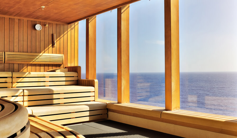 home sauna interior with a view of the water - Sauna Design Ideas