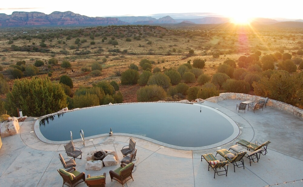 infinity pool on cliffside overlooking sagebrush landscape