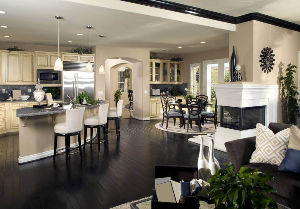 panoramic shot of open living area including corner kitchen - Large Kitchen Layouts