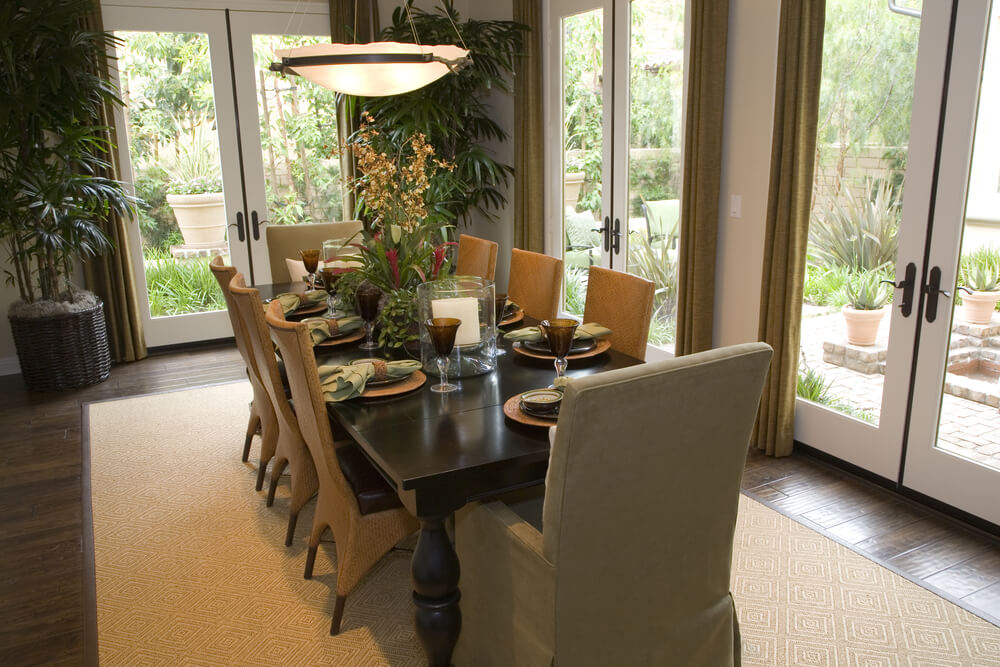 Casual dedicated dining room with 3 sets of double glass doors to the  backyard patio.