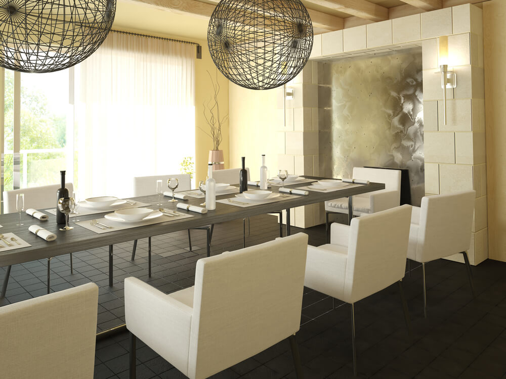 modern dining room design with long grey table surrounded by steel and white dining chairs