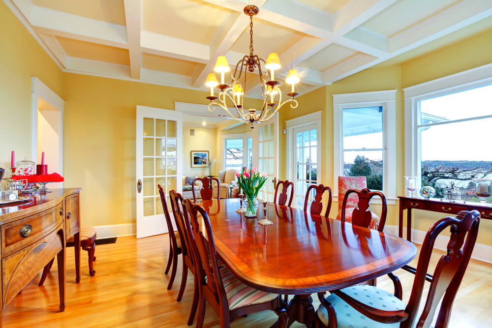 Large Yellow And White Dining Room With Wood Floor The Long Table Accommodates