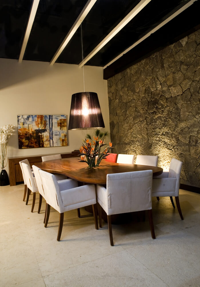 Dining Room In Retro Designed Home One Wall Is Stone Floor White