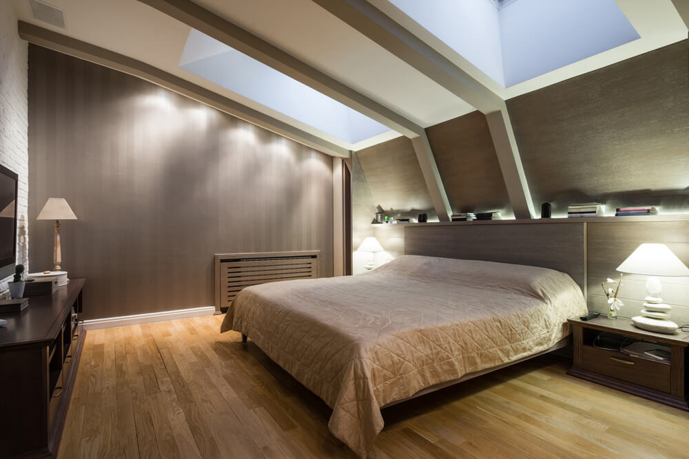 Modern bedroom with two skylights on sloped ceiling