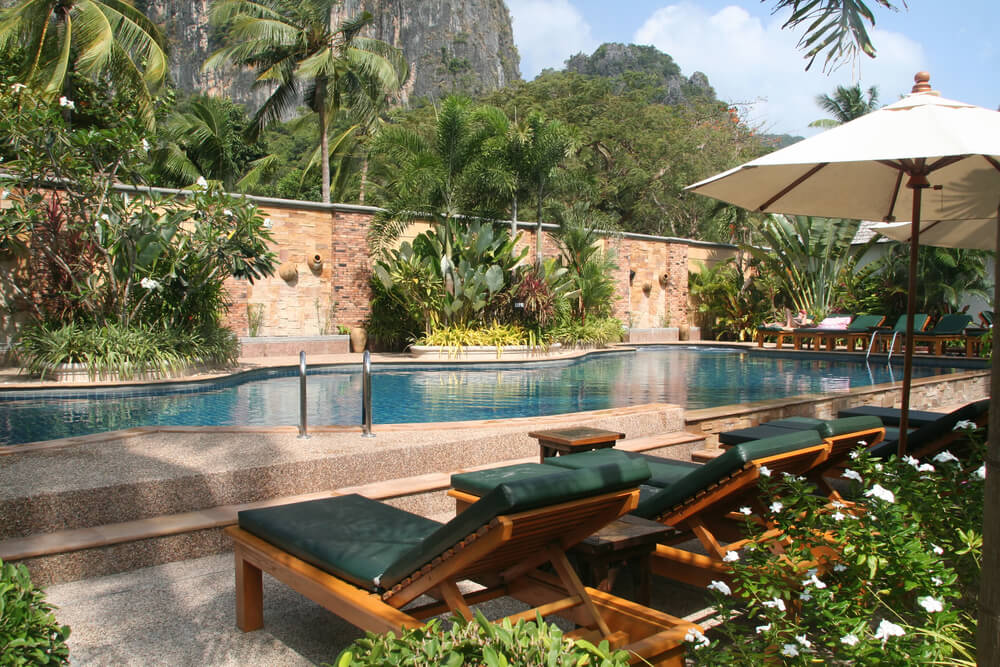 tropical pool area with gardens and privacy