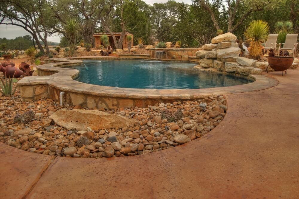 pool area on the backyard of a home in dry country side