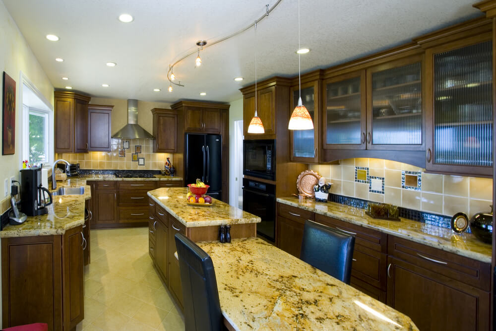 Long Rectangle Kitchen With Narrow Two Tiered Island Running Down The  Center.