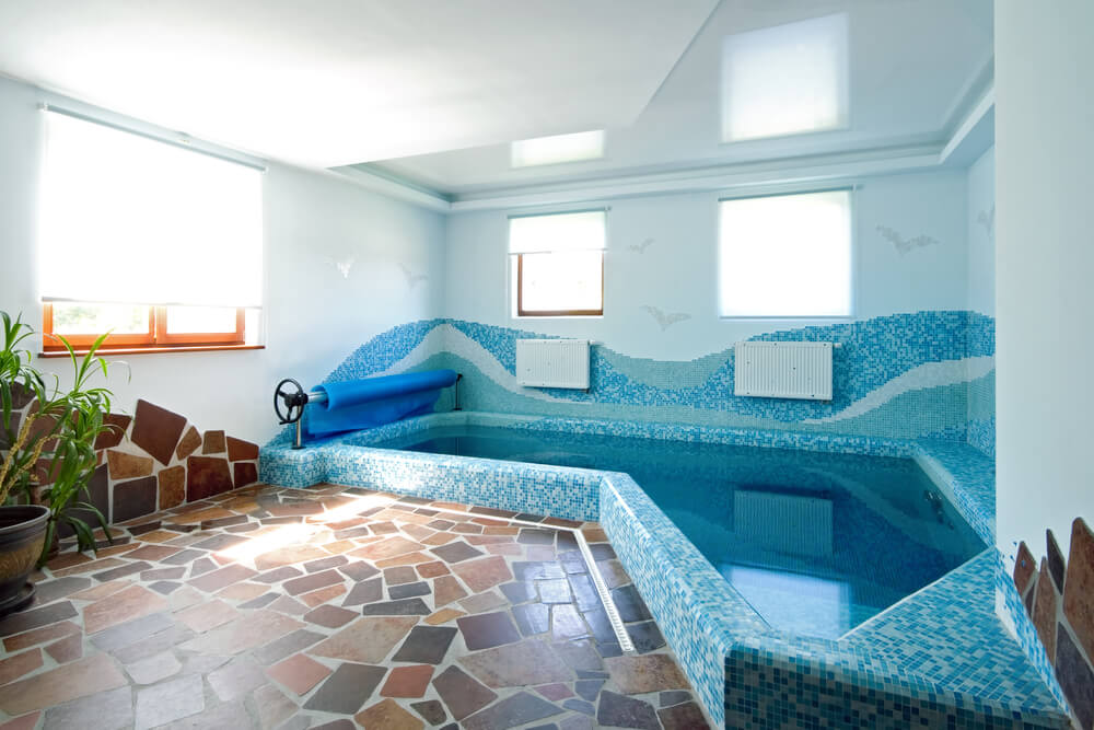 High Quality Small Indoor Pool With Blue Tile Patterns And Stone Work For A Small Inside  Pool Deck