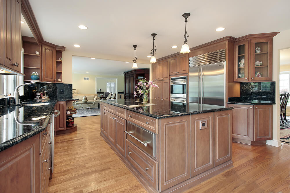 All wood kitchen with massive matching island.