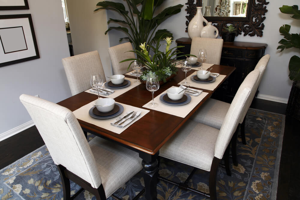 small dining room with white walls dark wood floor white dining room chairs and