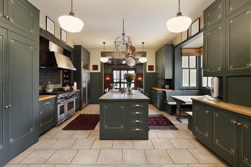 Dark green kitchen design with matching island.