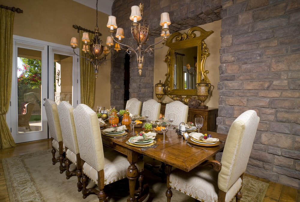 Ornate Dining Room With Brick Wall