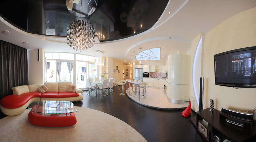 Modern, bordering on space-age living space design with curved design  throughout. Red
