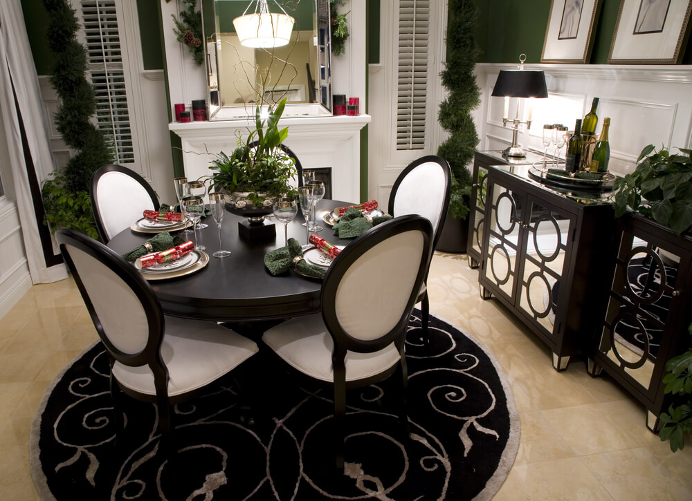 black white and green dining room black rug under black table and white chairs