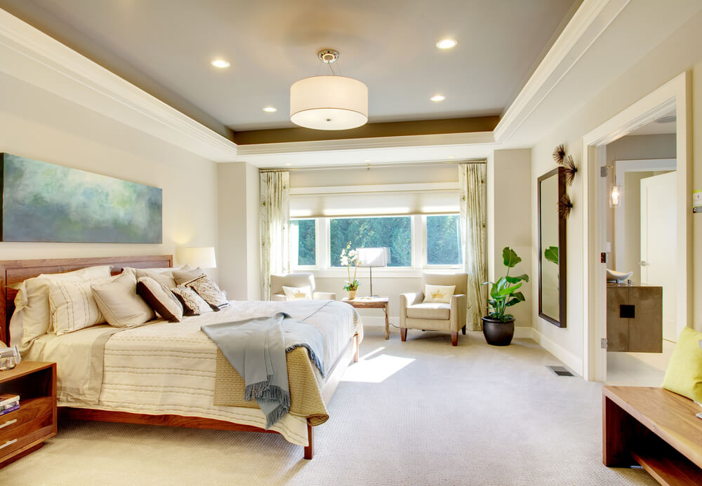 The white color scheme creates a bright oasis of a bedroom given that there is only one window