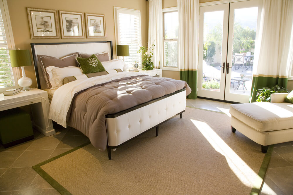 Natural light floods this master bedroom with windows along 2 walls