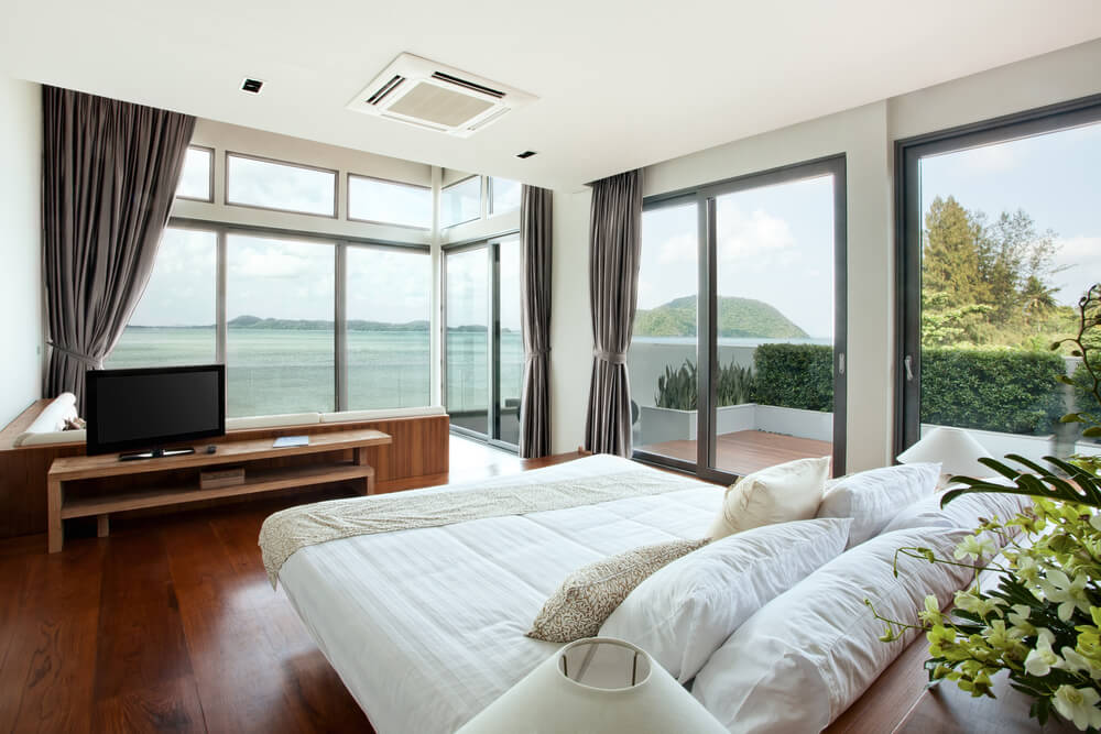 This bedroom is designed to take full advantage of the million dollar view of the ocean