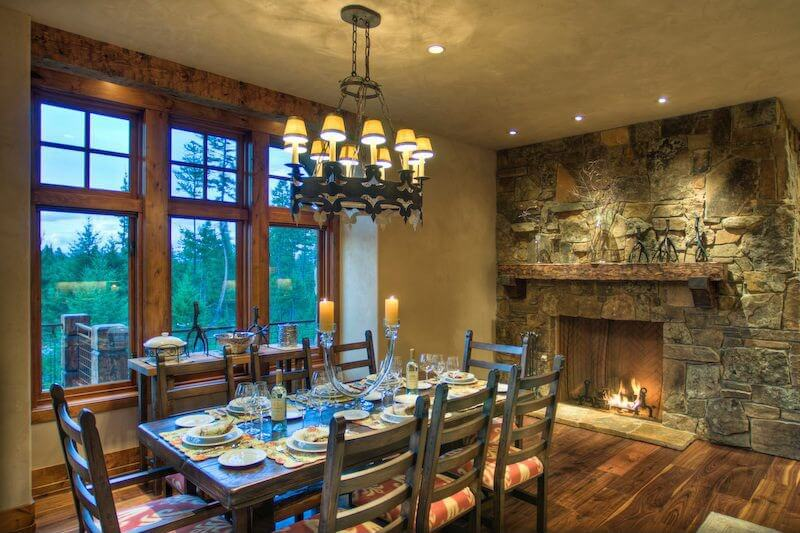Rustic Dining Room Design With Large Stone Fireplace And Wall Natural Wood Framed Windows