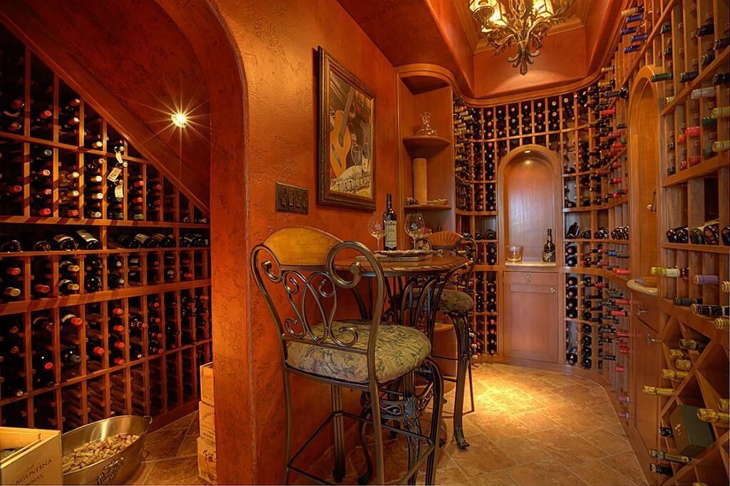 Richly Designed Wine Cellar Room With Chandelier Floor To