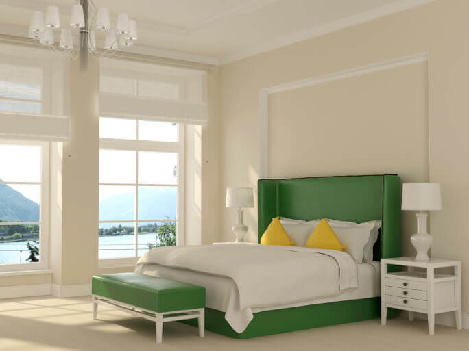 Off White Bedroom With Tall Ceilings, Chandelier, Several Windows With View  Of The