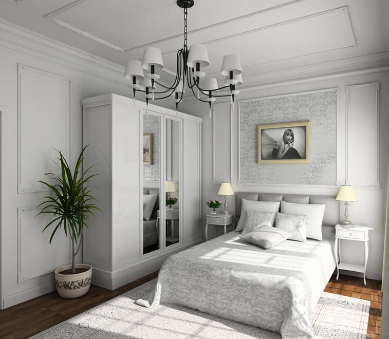 Ornately decorated bedroom with white paneling, built-in white wardrobe,  wood floor and