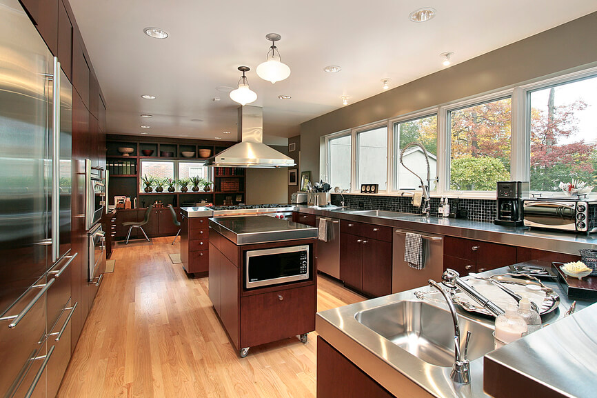 Kitchen With Stainless Steel Counters Looks Good