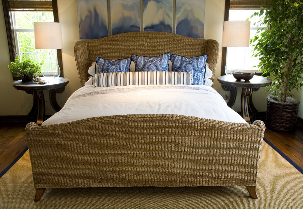 large wicker bed frame dominates this compact room featuring matching rug over hardwood flooring dark