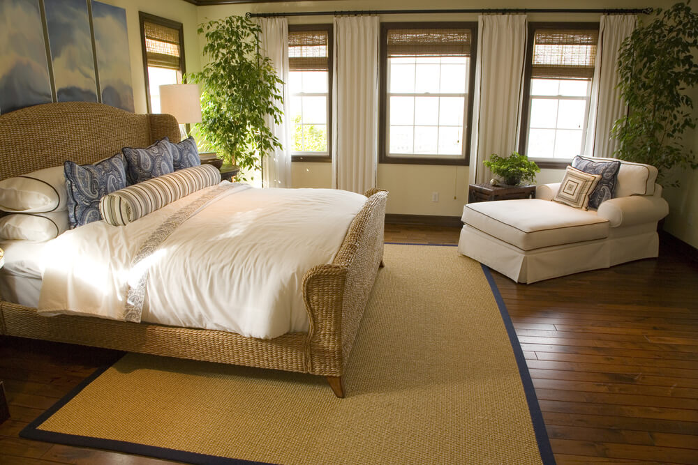natural wood panel hard flooring here sets off the wicker bed frame and off white - Wicker Bed Frame