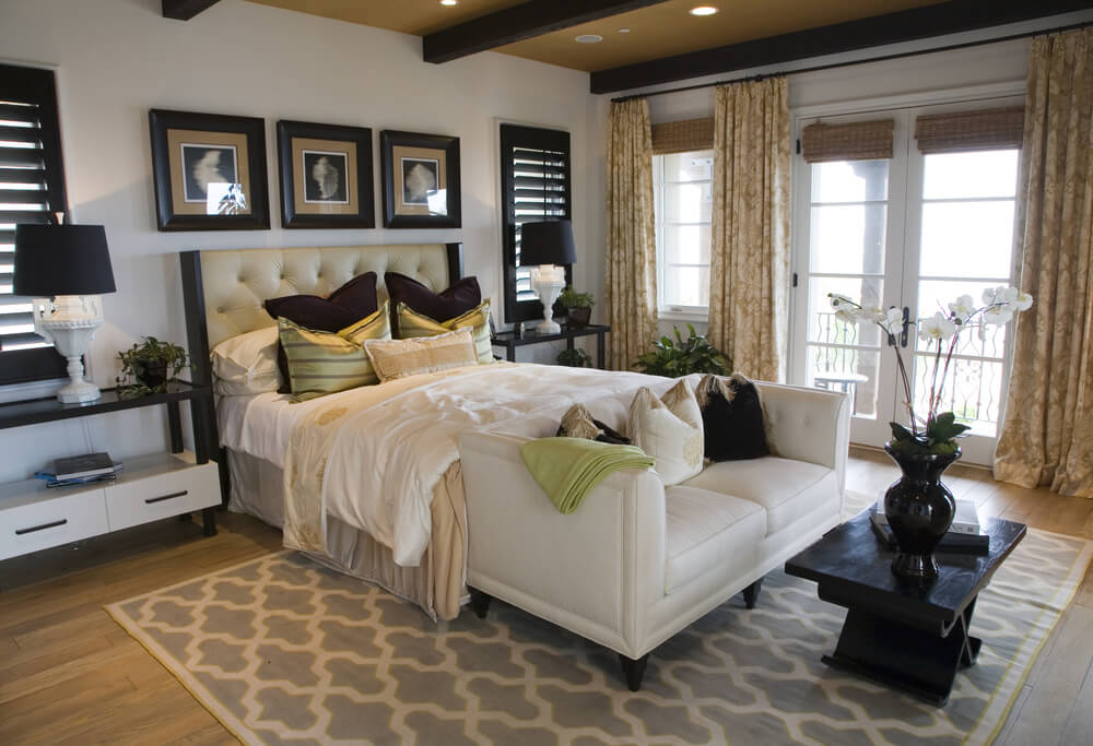 this bedroom is a bright contrast with white love seat sheets walls