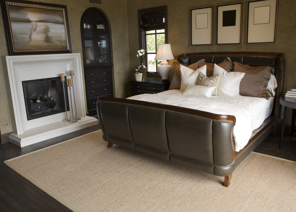 Elegant, Dark Leather Bound Bed Frame Is The Centerpiece Of This Bedroom  Featuring A