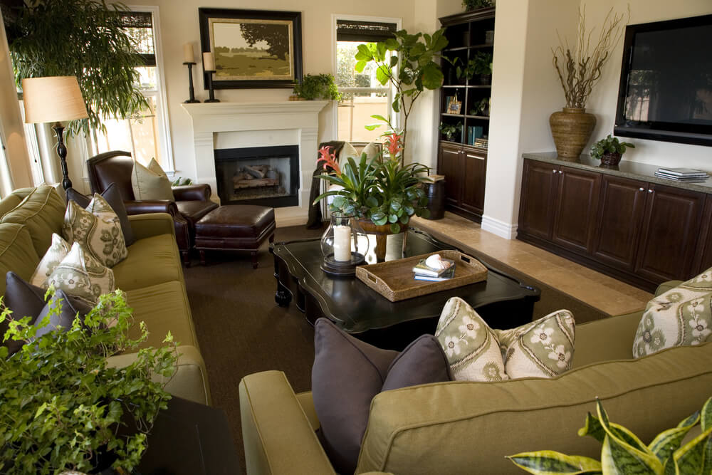 Richly Designed Living Room In Dark Brown Green And White Color Scheme Is