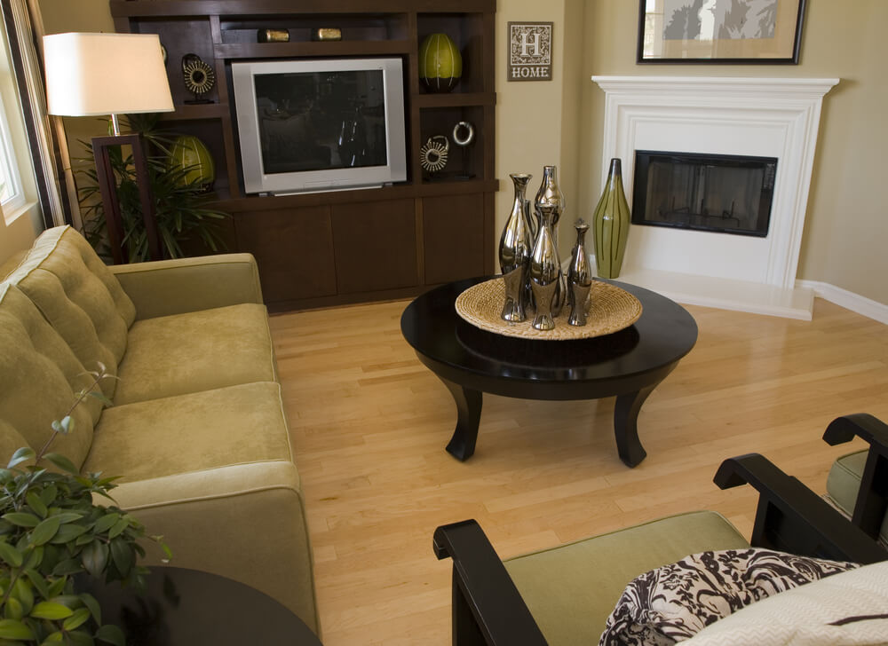 Modern Polished Black Wood Coffee Table And Chairs Are Paired With Light Green Cushions A