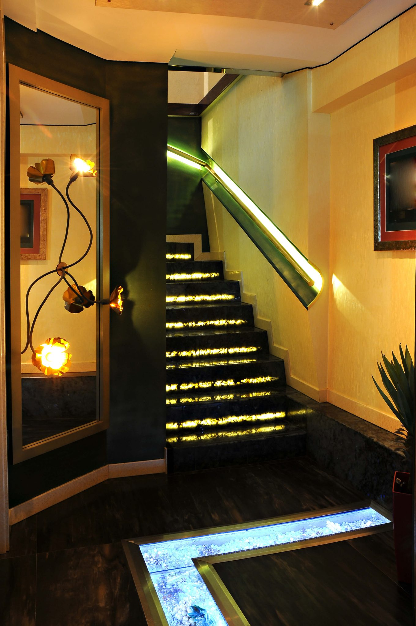 Dark stairs with under-step lighting and a lit railing