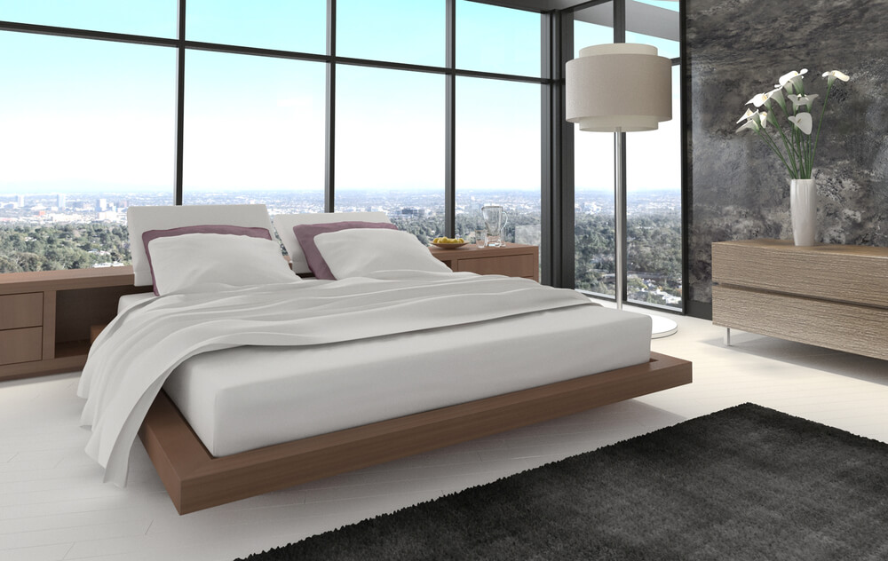 Bedroom in condo with incredible view. Bedroom floor and bedding in white  along with white