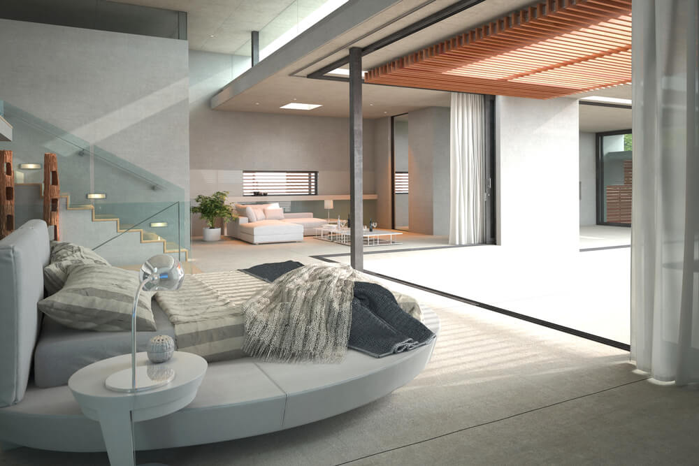 Modern bedroom part of open concept home with glass wall and floor-to-ceiling picture window.