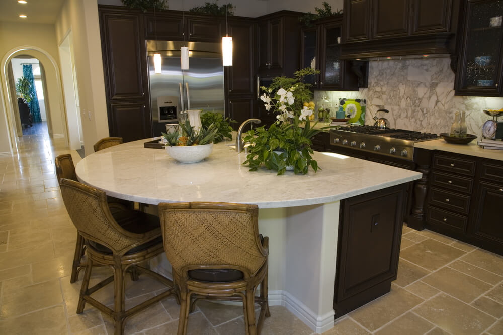 Large half-circle white-topped kitchen island with seating for four people  make up