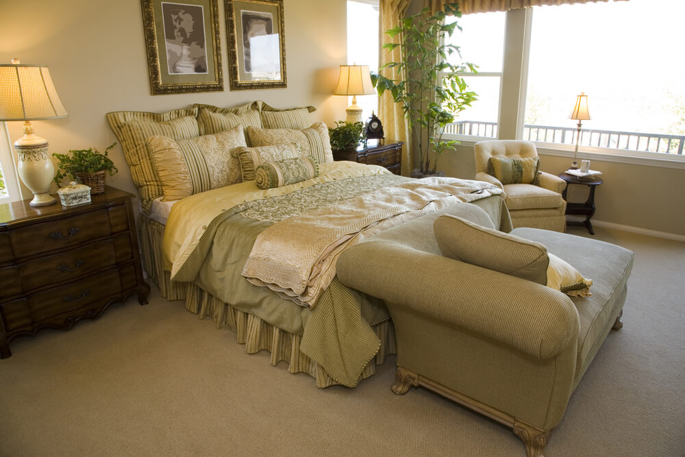 Gold Tones Give This Cozy Bedroom A Classic Air Amplified By The Dark Wood Dresser
