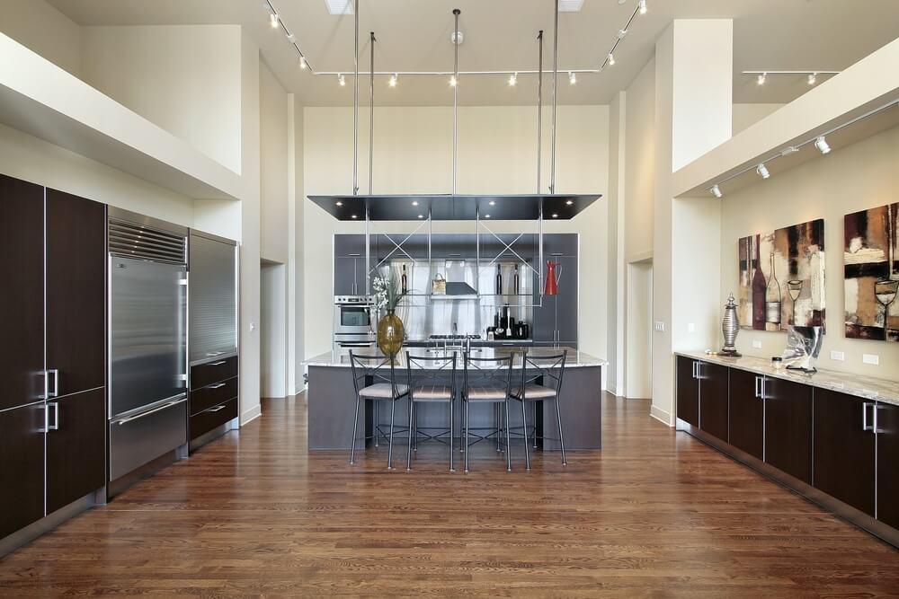 Dark Hardwood Floor love this dark brown wood floors Modernist Kitchen Highlighted By Extensive Metal Work Over Natural Hardwood Floor And Dark Minimal Wooden Cabinet