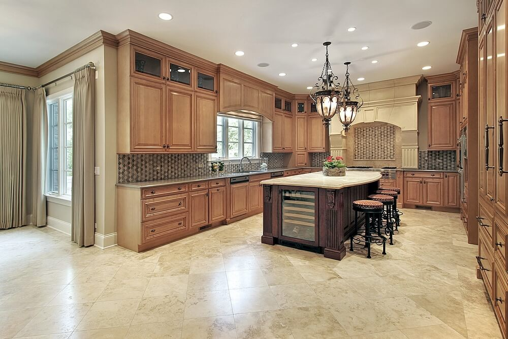 Here's another example of a large kitchen featuring the upper, open-view cabinets with glass doors.