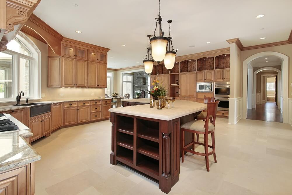 Of Standard Light Wood Tone Cabinets And A Light Sand Colored Floor