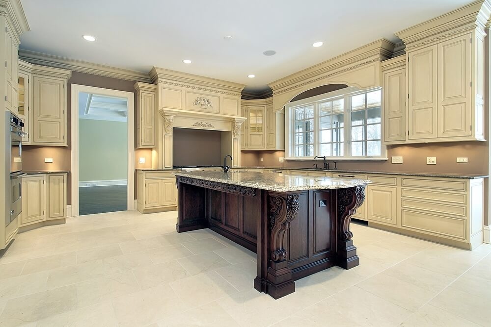 With Cabinetry Similar To The Prior Kitchen, This Example Features A Dark  Stained Wooden Island