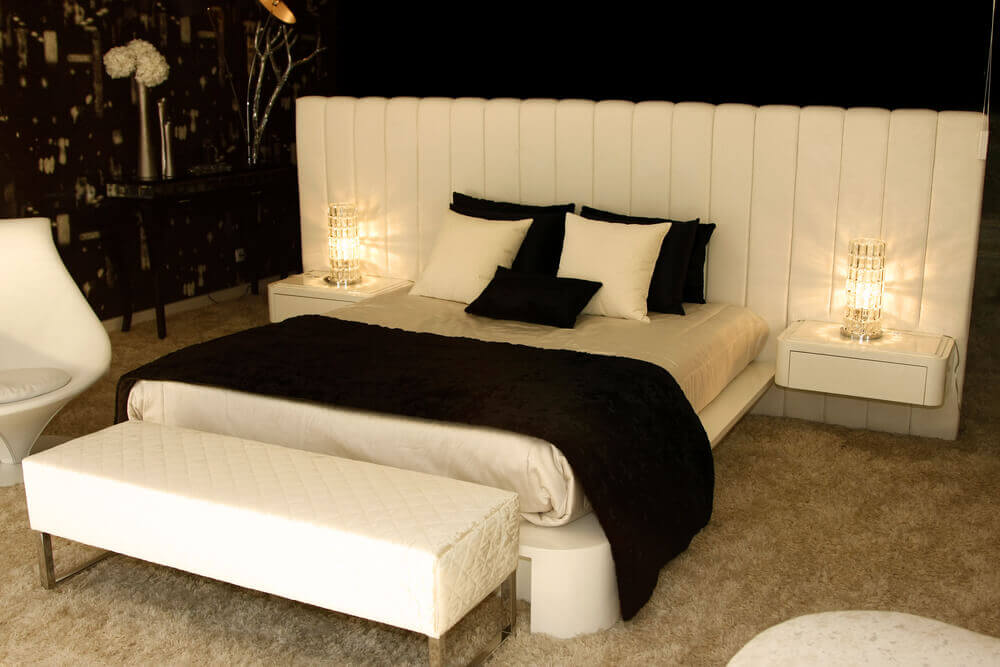 Dark Bedroom Design With Massive Bed Unit Which Includes White Padded  Headboard, Floating White Nightstands