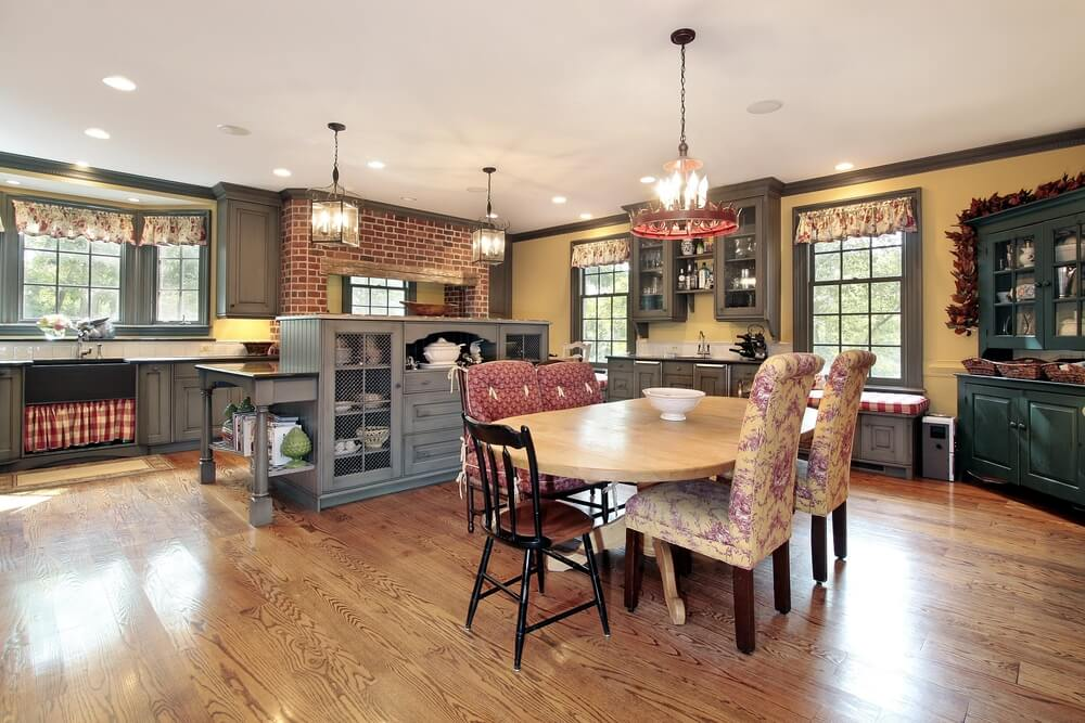Traditional kitchen featuring a range of textures on every wooden surface, unified by light natural hardwood flooring.