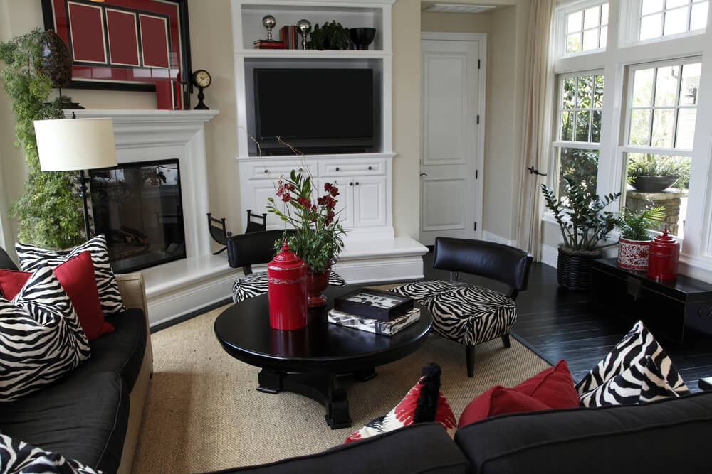 casual living room decorated heavily in black with black sofas dark