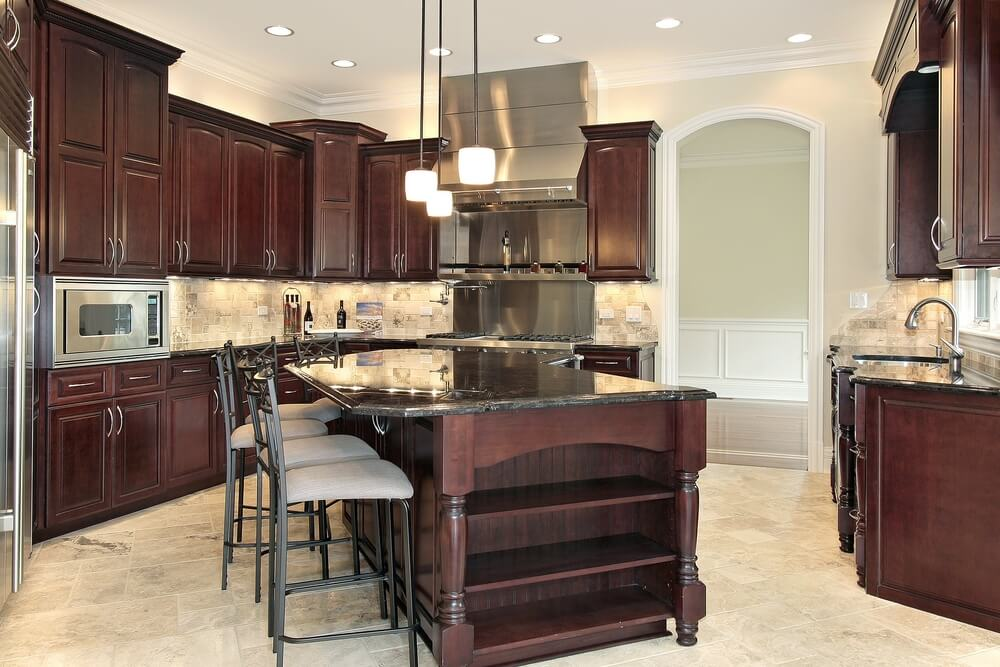 kitchen design wood cabinets. imposing dark wood island with black countertop dominates this kitchen featuring brushed aluminum appliances. design cabinets