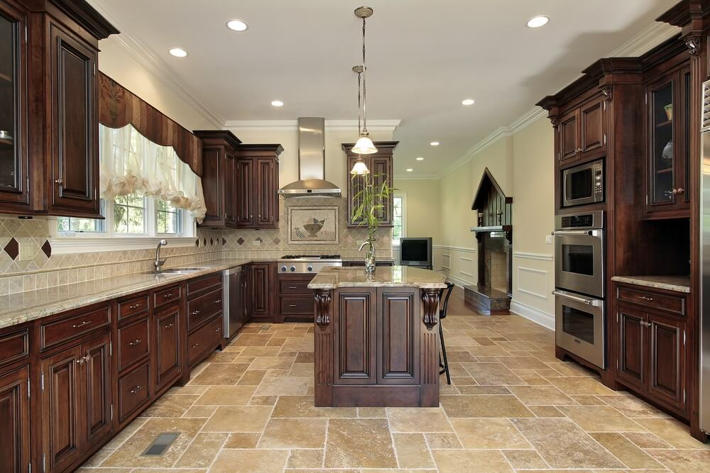kitchen is strengthened by dark wood over the light tile flooring and